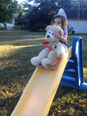 Mr. Bear had to slide down in her lap!